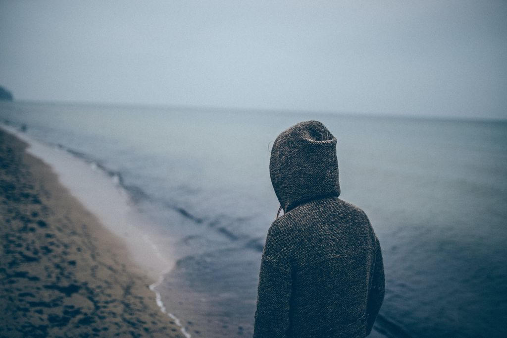 Lonely person walking on a beach